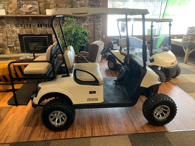 2016 EZGO RXV Gas Golf Cart with Flip rear Seat, Lift Kit, 10″ Tires / Aluminum Rims, & LED Lighting